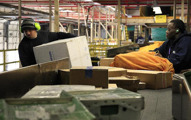 In this Tuesday, Dec. 11, 2012, photo, FedEx workers sort packages at the Oakland Regional Sort Facility in Oakland, Calif. U.S factory orders increased 1.8 percent in December from November when orders had fallen 0.3 percent.  (AP Photo/Ben Margot)
