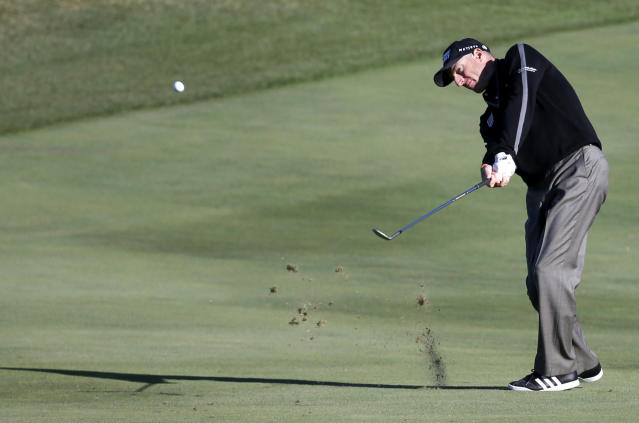 Jim Furyk hits his approach shot on the ninth fairway during the second round of the BMW Championship golf tournament at Conway Farms Golf Club in Lake Forest, Ill., Friday, Sept. 13, 2013. Furyk posted a single-round 59, becoming the sixth player to reach that milestone. (AP Photo/Charles Rex Arbogast)