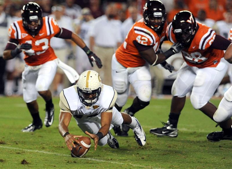 Georgia Tech quarterback Tevin Washington dives on the ball to regain possession while under pressure from Virginia Tech outside linebacker Jeron Gouveia-Winslow and defensive end J.R. Collins (42) during the first half of an NCAA college football game, Monday, Sept. 3, 2012, in Blacksburg, Va. (AP Photo/Don Petersen)