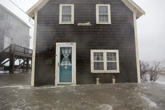 <p>Floodwaters near the entrace to a home on Lighthouse Rd. during a large coastal storm on March 2, 2018 in Scituate, Mass. (Photo: Scott Eisen/Getty Images) </p>