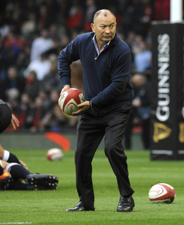 FILE - In this Feb. 23, 2019, file photo, England rugby head coach Eddie Jones prepares to pass the ball as his team prepares for the Six Nations rugby union international between Wales and England at the Principality Stadium in Cardiff, Wales. England has had wild fortunes this Rugby World Cup cycle under Eddie Jones but appears to be running into good form ahead of the tournament in Japan. (AP Photo/Rui Vieira, File)