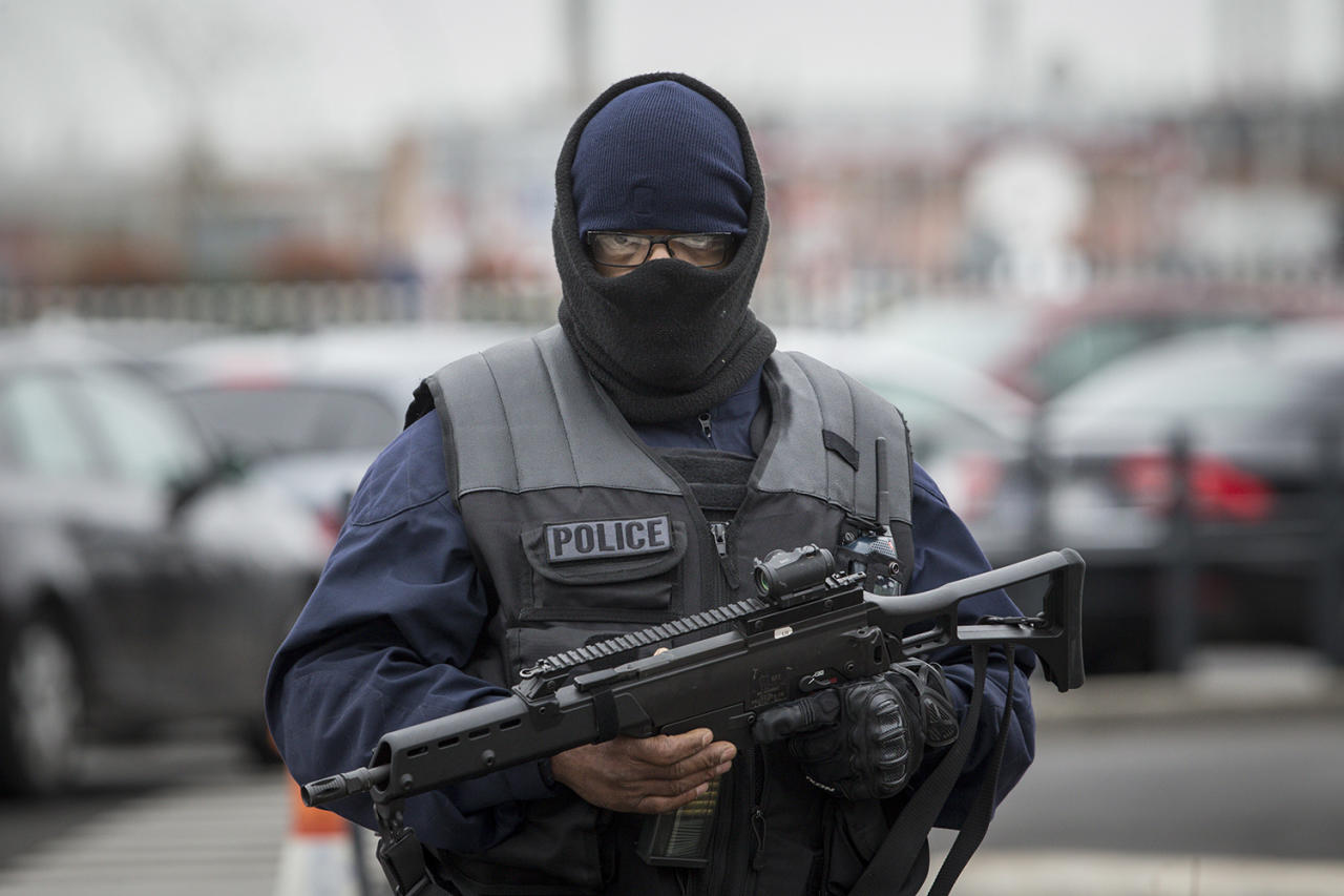 <p>An elite police officer patrols at Orly airport, south of Paris, Saturday, March, 18, 2017. A man was shot to death Saturday after trying to seize the weapon of a soldier guarding Paris' Orly Airport, prompting a partial evacuation of the terminal, police said. (AP Photo/Kamil Zihnioglu) </p>