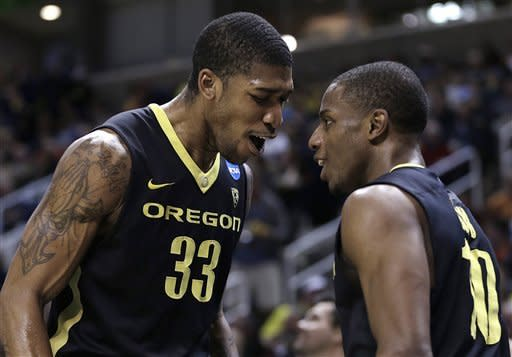 Oregon's Carlos Emory, left, and Johnathan Loyd celebrate at the end of a third-round game in the NCAA college basketball tournament against Saint Louis Saturday, March 23, 2013, in San Jose, Calif. Oregon won the game, 74-57. (AP Photo/Ben Margot)