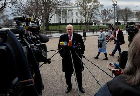 FILE PHOTO: German Economic Minister Peter Altmaier delivers a statement regarding the Trump Administration's steel and aluminum tariffs outside of the White House in Washington, U.S., March 19, 2018. REUTERS/ Leah Millis