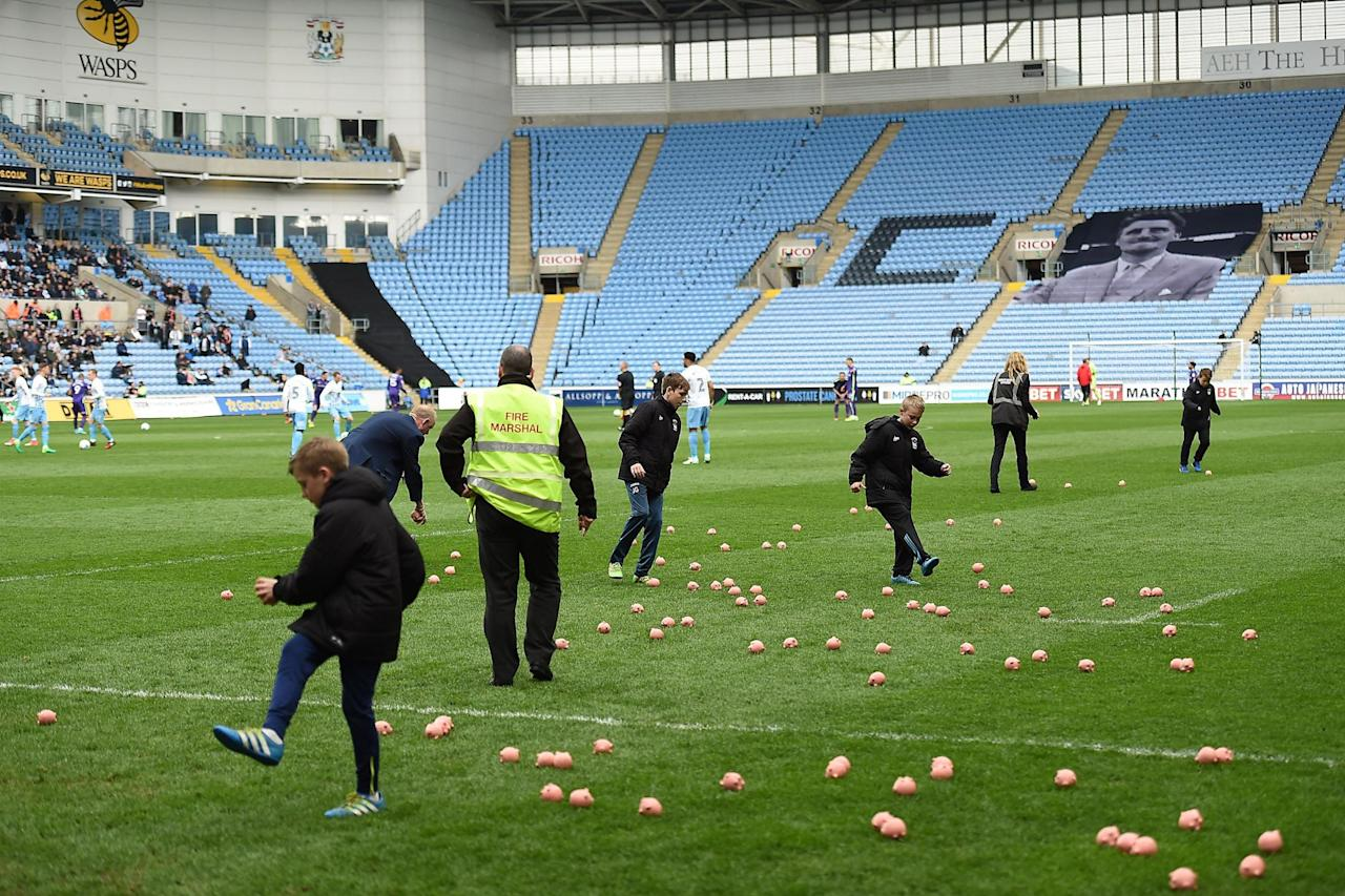 The pigs are back! Charlton's match with Coventry delayed again by plastic pigs in protests against club owners