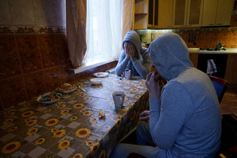 Gay men who fled persecution in Russia's Muslim region of Chechnya due to their sexual-orientation sit in a Moscow apartment on April 17, 2017