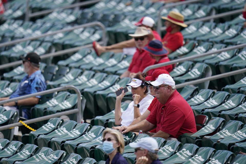 Fans sit in a socially distant pods inside Roger Dean Stadium during a spring training baseball game between the St. Louis Cardinals and Washington Nationals Sunday, Feb. 28, 2021, in Jupiter, Fla. (AP Photo/Jeff Roberson)