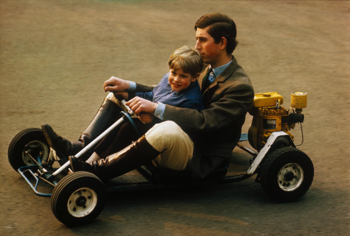 (Original Caption) Go carting is a sport usually for one person at a time, but in the secluded grounds of the family home at Windsor, Prince Charles takes his younger brother Prince Edward for a spin in this photograph.
