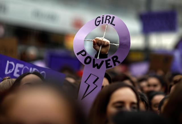 <p>Demonstrators attend a protest at the Puerta del Sol square during a one-day strike to defend women's rights on International Women's Day in Madrid on March 8, 2018. Spain celebrated International Women's Day today with an unprecedented general strike in defense of women's rights that saw hundreds of train journeys canceled and countless protests scheduled throughout the day. (Photo: Oscar Del Pozo/AFP/Getty Images) </p>