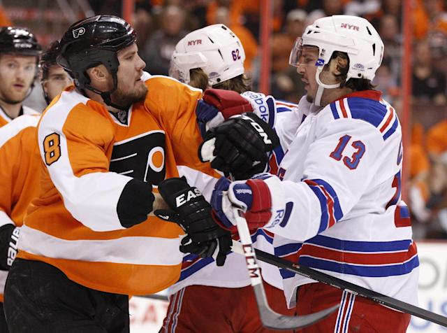 Philadelphia Flyers' Nicklas Grossmann, left, of Sweden, gets into a pushing match with New York Rangers' Daniel Carcillo during the first period in Game 3 of an NHL hockey first-round playoff series, Tuesday, April 22, 2014, in Philadelphia. (AP Photo/Chris Szagola)