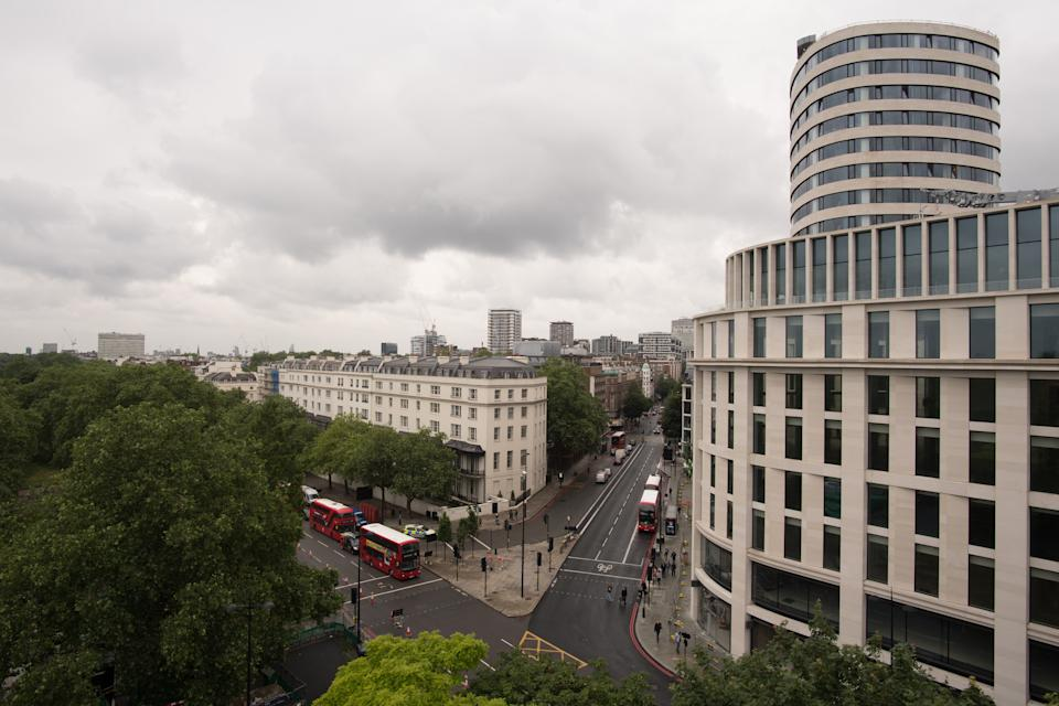 The view from the Marble Arch Mound in central London. The summit of the new 25-metre high installation will provide sweeping views of Hyde Park, Mayfair and Marylebone when it opens to the public in July. The artificial hill has been built on a scaffolding base, with layers of soil and plywood forming the mound which has a hollow centre with space for exhibitions and displays. Picture date: Monday June 21, 2021.