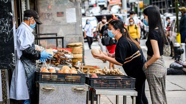 PHOTO: People wear protective face masks at a seafood market in China Town as the city continues Phase 4 of re-opening following restrictions imposed to slow the spread of coronavirus on Aug. 18, 2020, in New York. (Noam Galai/Getty Images)