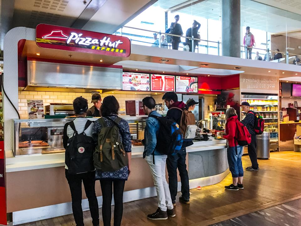 Oslo, Norway - July 26, 2015: People buying food at Pizza Hut Express, Oslo Airport