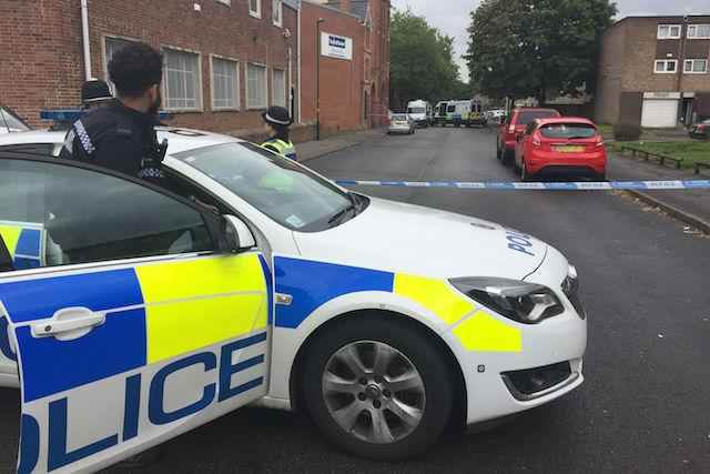 EDITORS NOTE: NUMBER PLATE PIXELATED BY PA PICTURE DESK Police at the scene in Ladywood, Birmingham where police in an unmarked car were shot at during an operation to crack down on gun crime.