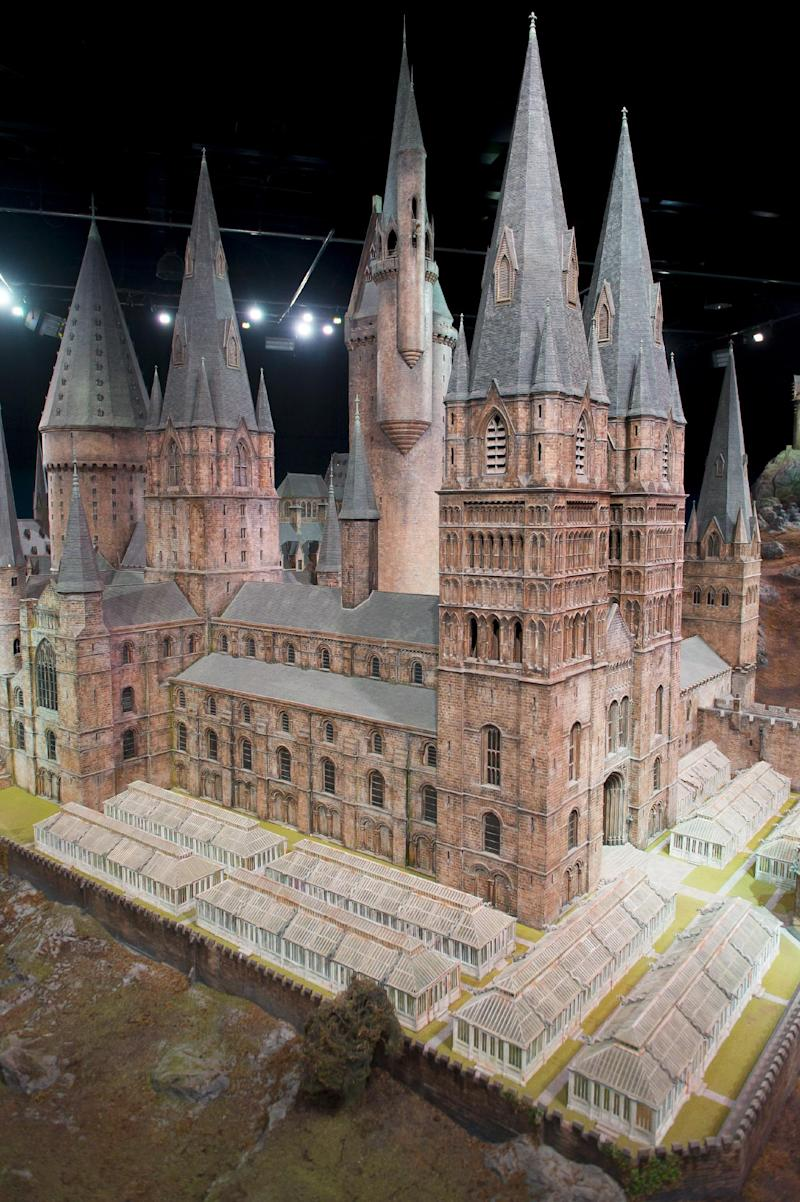 """FILE  - This is a Thursday, March 1, 2012 file photo of a model of Hogwarts Castle from the Harry Potter film series is unveiled at the Warner Bros Studio Tour, Watford, London.  A monumental model of the school for young witches and wizards is part of """"The Making of Harry Potter,"""" a studio tour based at the Warner Bros. facility near London where the eight movies were shot between 2000 and 2010. (AP Photo/Jonathan Short, File)"""
