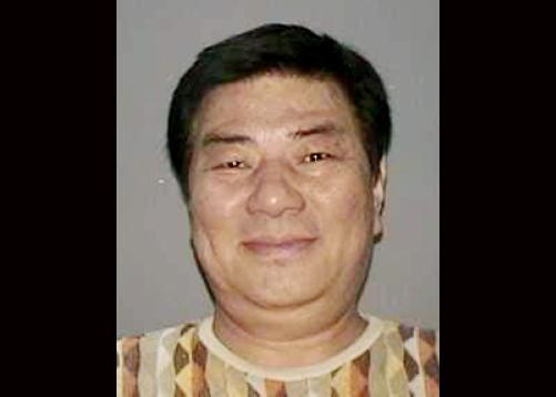 In this undated photo provided by the Nassau County Police Department in Mineola, N.Y. on Wednesday, Sept. 25, 2013, a New York State Driver's License photo of Sang Ho Kim is shown. Police say that Kim walked into a suburban light fixture company where he had done business as a vendor and opened fire Wednesday, killing one employee, wounding another person and leading to the lockdown of a nearby mall. Police said that Kim fled the scene in a white SUV. (AP Photo/Nassau County Police Department)