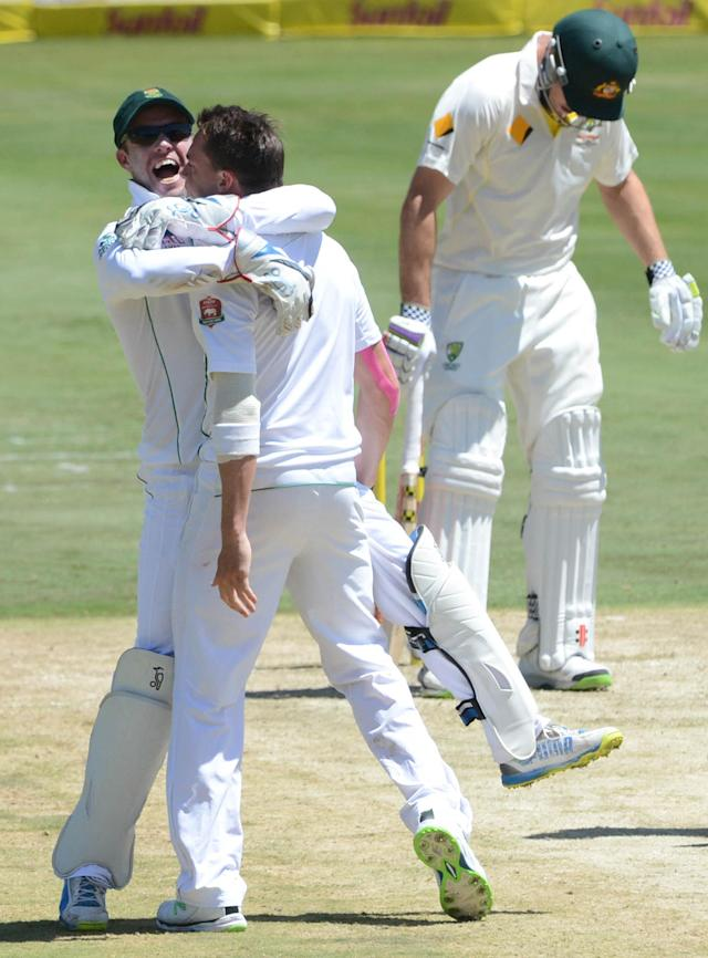 PRETORIA, SOUTH AFRICA - FEBRUARY 12: AB de Villiers and Dale Steyn of South Africa celebrate the wicket of Michael Clarke of Austrailia during day one of the First Test match between South Africa and Australia at SuperSport Park on February 12, 2014 in Centurion, South Africa. (Photo by Lee Warren/Gallo Images/Getty Images)