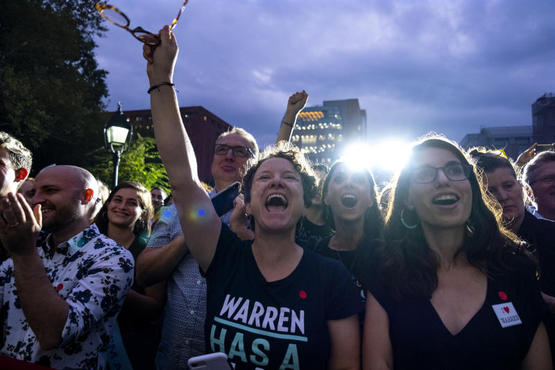 Supporters of Democratic presidential candidate U.S. Sen. Elizabeth Warren cheer as she arrives at a rally, Monday, Sept. 16, 2019, in New York. (AP Photo/Craig Ruttle)