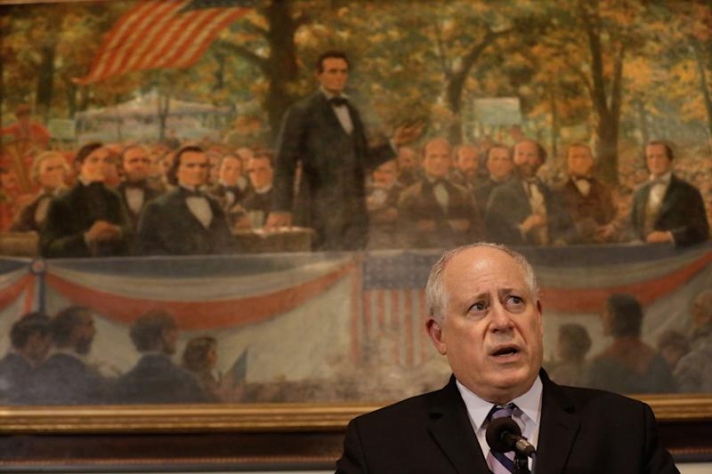 Illinois Gov. Pat Quinn speaks with reporters after pension legislation passed at the Illinois State Capitol Tuesday, Dec. 3, 2013 in Springfield, Ill. (AP Photo/Seth Perlman)
