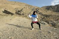 A Hazara student practises Shaolin Kung Fu during a self-defence martial arts training class, on the outskirts of Quetta