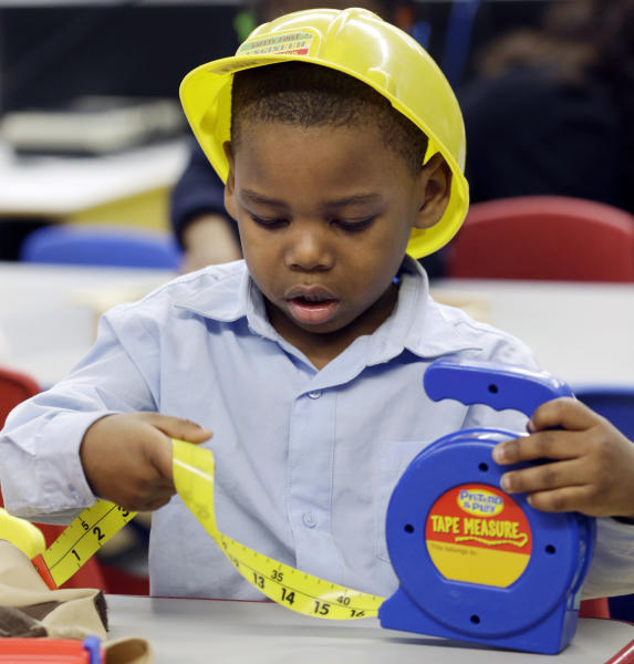 In this Friday, March 1, 2013 photo, Laneer Reed-Fryer works on a construction-theme project during his prekindergarten class at a public school in Buffalo, N.Y. President Barack Obama's proposal to expand access to preschool is seen as a way to close the achievement gap for poor and minority students, improve high school graduation rates and ultimately strengthen the workforce. (AP Photo/David Duprey)