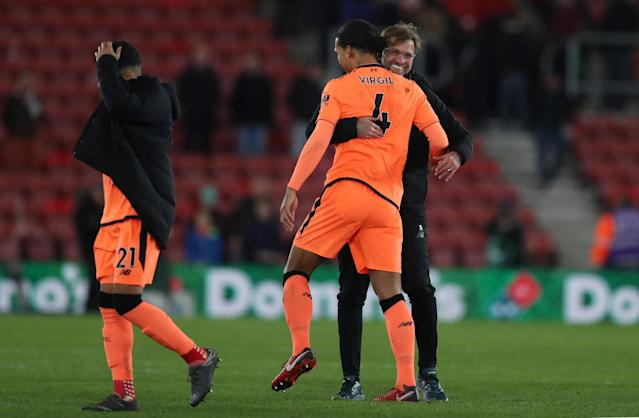 "Soccer Football - Premier League - Southampton vs Liverpool - St Mary's Stadium, Southampton, Britain - February 11, 2018 Liverpool manager Juergen Klopp celebrates with Virgil van Dijk at the end of the match Action Images via Reuters/Peter Cziborra EDITORIAL USE ONLY. No use with unauthorized audio, video, data, fixture lists, club/league logos or ""live"" services. Online in-match use limited to 75 images, no video emulation. No use in betting, games or single club/league/player publications. Please contact your account representative for further details."
