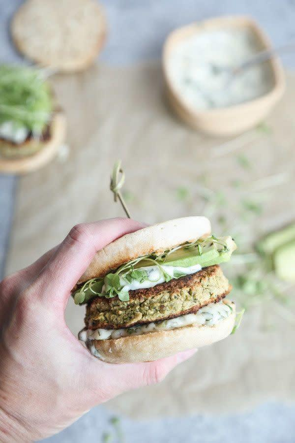 """<strong>Get the <a href=""""https://feedmephoebe.com/gluten-free-white-bean-zucchini-burgers/"""" rel=""""nofollow noopener"""" target=""""_blank"""" data-ylk=""""slk:Gluten-Free White Bean Zucchini Burgers"""" class=""""link rapid-noclick-resp"""">Gluten-Free White Bean Zucchini Burgers </a>recipe from Feed Me Phoebe</strong>"""