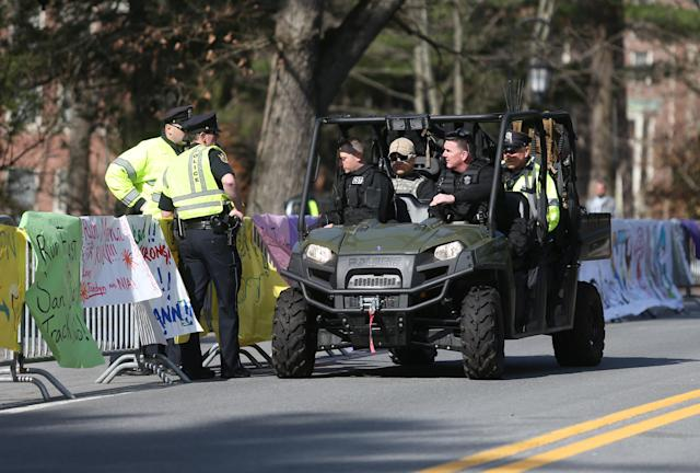 Police officers give a rundown of the scene at Wellesley College to a State Police Special Response team before the start of the 118th Boston Marathon Monday, April 21, 2014 in Wellesley. (AP Photo/Mary Schwalm)