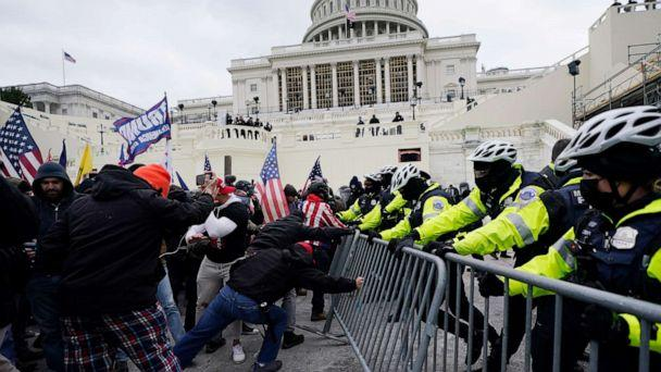 PHOTO: Supporters of U.S. President Donald Trump try to break through a police barrier at the U.S. Capitol in Washington, D.C., on Jan. 6, 2021. (Julio Cortez/AP)