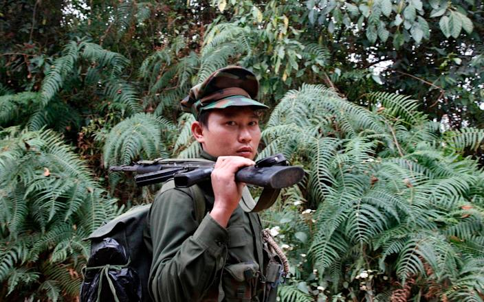A Kachin Independent Army fighter in northern Kachin state - Esther Htusan/AP