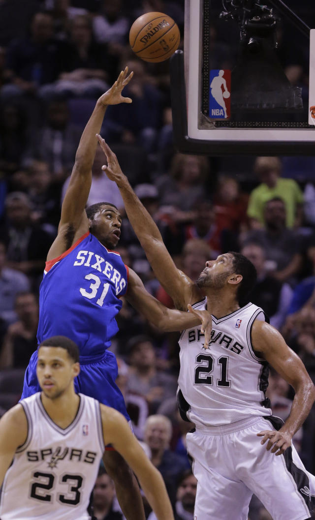 The 76ers' Hollis Thompson (31) shoots over San Antonio Spurs' Tim Duncan (21) during the first half of an NBA basketball game, Monday, March 24, 2014, in San Antonio. (AP Photo/Eric Gay)