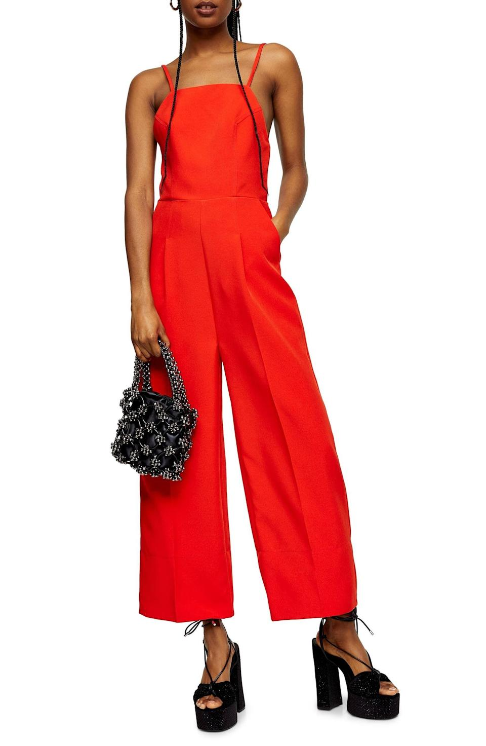 """<p><strong>TOPSHOP</strong></p><p>nordstrom.com</p><p><strong>$71.25</strong></p><p><a href=""""https://go.redirectingat.com?id=74968X1596630&url=https%3A%2F%2Fshop.nordstrom.com%2Fs%2Ftopshop-strappy-back-wide-leg-jumpsuit%2F5549125&sref=https%3A%2F%2Fwww.goodhousekeeping.com%2Fholidays%2Fg32302046%2Ffourth-of-july-outfit-ideas%2F"""" rel=""""nofollow noopener"""" target=""""_blank"""" data-ylk=""""slk:Shop Now"""" class=""""link rapid-noclick-resp"""">Shop Now</a></p><p>July Fourth is a busy holiday, and many of us spend the day going from parade to picnic to party. Change from sneakers and colorful beads to heels and a star pattern purse, and this festive jumpsuit will keep you styling all day long. </p>"""