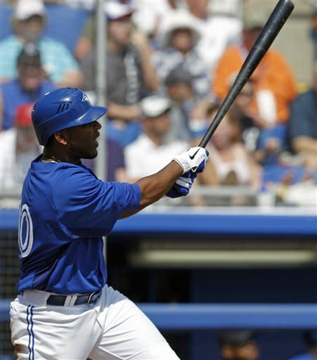 Toronto Blue Jays designated hitter Edwin Encarnacion watches his three-run home run off New York Yankees relief pitcher Manuel Banuelos during the third inning of their spring training baseball game in Dunedin, Fla., Wednesday, March 14, 2012. (AP Photo/Kathy Willens)