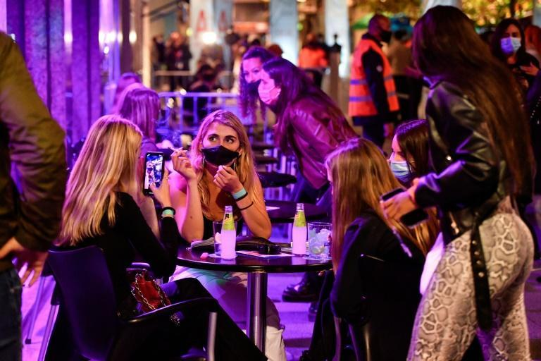 400 masked participants were asked to bar hop, dance and drink at cafes and clubs in the Spanish town of Sitges