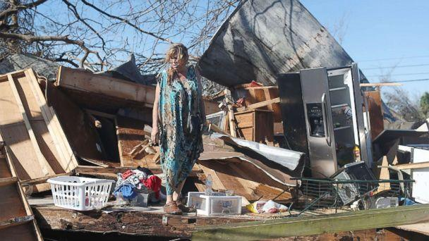 PHOTO: Kathy Coy stands among what is left of her home after Hurricane Michael destroyed it on Oct. 11, 2018 in Panama City, Florida. She said she was in the home when it was blown apart and is thankful to be alive.  (Joe Raedle/Getty Images)