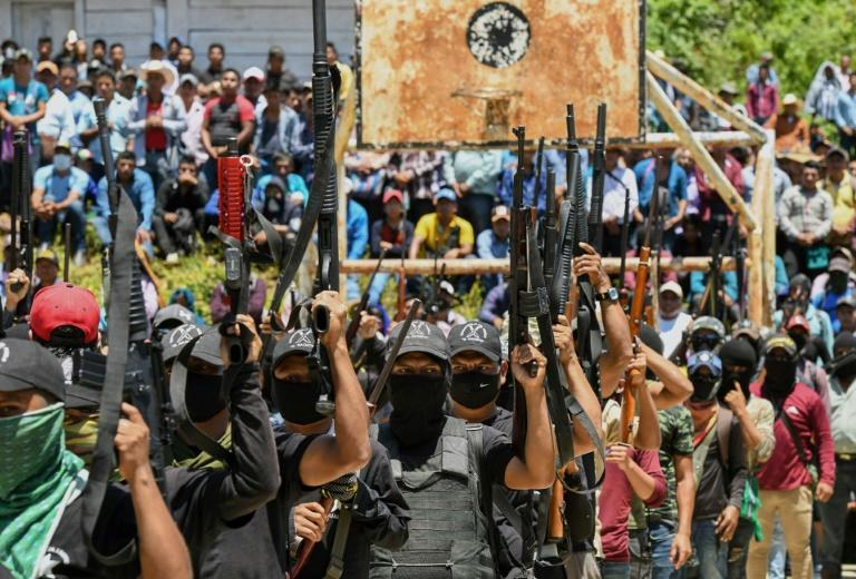 """Members of the new Mexican self-defense group """"El Machete"""" parade with their weapons in Pantelho in the southern state of Chiapas"""