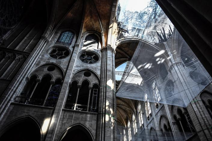 Damage on the nave and rubble during preliminary work in the Notre Dame Cathedral three months after a major fire July 17, 2019 in Paris. (Photo: Stephane de Sakutin/Pool via AP)
