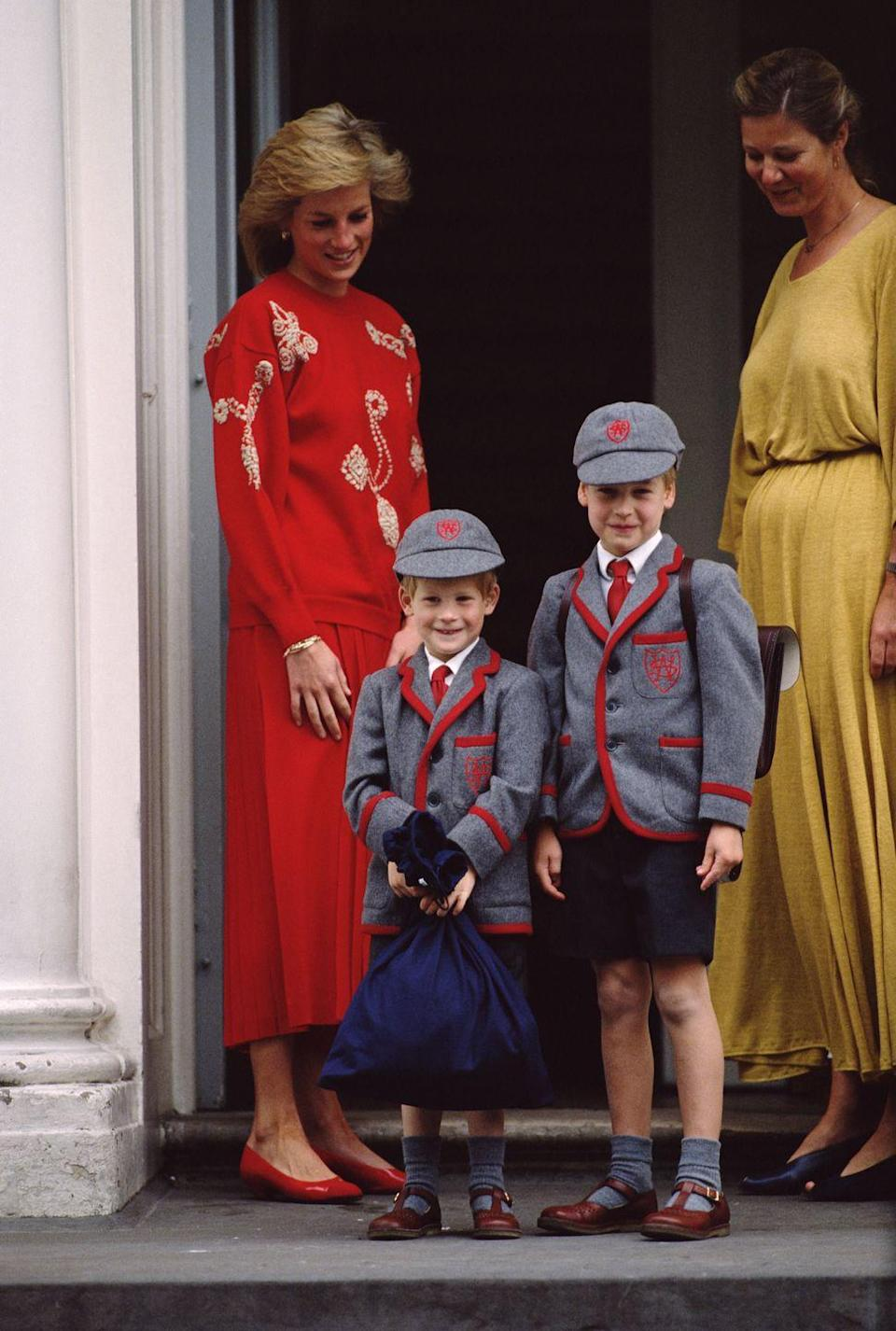 <p>Prince William joins his younger brother for his first day of school. The two give the press a smile as they enter and, of course, are accompanied by their mother Princess Diana. </p>