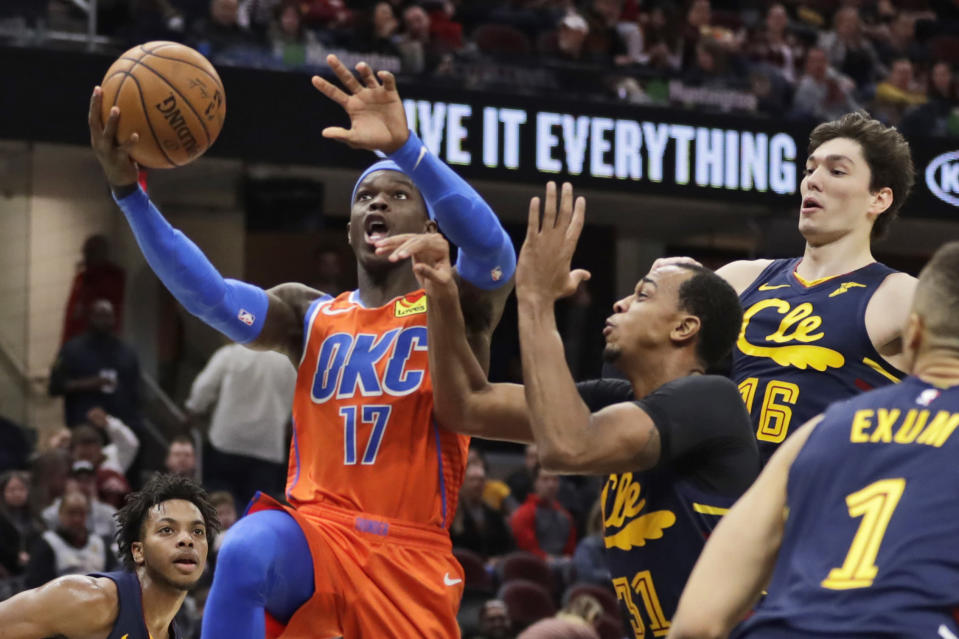 Oklahoma City Thunder's Dennis Schroder (17) drives against Cleveland Cavaliers' John Henson (31) in the second half of an NBA basketball game, Saturday, Jan. 4, 2020, in Cleveland. Oklahoma won 121-106. (AP Photo/Tony Dejak)