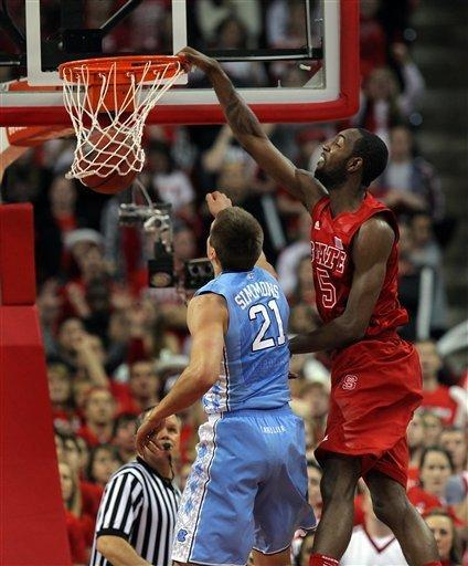 North Carolina State's C.J. Leslie (5) dunks over North Carolina's Jackson Simmons (21) during the first half of an NCAA college basketball game in Raleigh, N.C., Saturday, Jan. 26, 2013. (AP Photo/Ted Richardson)
