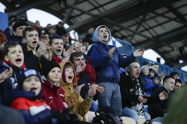 FILE In this file photo taken on Friday, March 27, 2020, young fans of Torpedo-BelAZ Zhodino react during the Belarus Championship soccer match between Torpedo-BelAZ Zhodino and Belshina Bobruisk in the town of Zhodino, Belarus. Soccer fans from two clubs in Belarus say they will stop going to games because of the coronavirus. Belarus is the only nation in Europe still hosting professional soccer games with fans in the stadium. The new coronavirus causes mild or moderate symptoms for most people, but for some, especially older adults and people with existing health problems, it can cause more severe illness or death. (AP Photo/Sergei Grits, File)