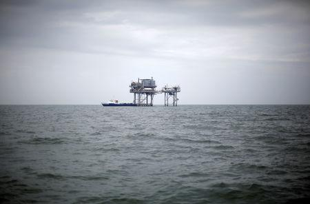 FILE PHOTO: A drilling platform is seen near Breton Island, Louisiana May 3, 2010. REUTERS/Carlos Barria/File Photo
