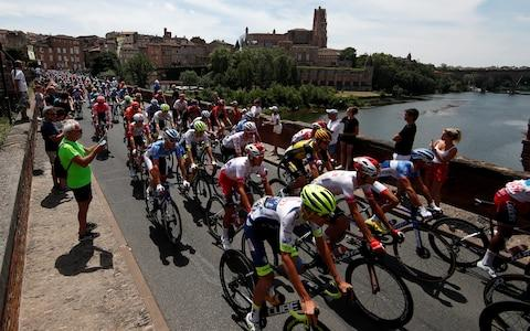 <span>The peloton rolls out of Albi during the neutralised section of Wednesday's stage</span> <span>Credit: REUTERS </span>