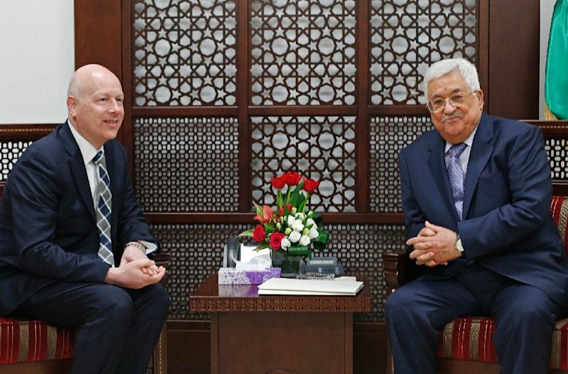 Palestinian president Mahmoud Abbas meets Jason Greenblatt, the US president's special representative for international negotiations, at his office in Ramallah on March 14, 2017 (AFP Photo/ABBAS MOMANI)