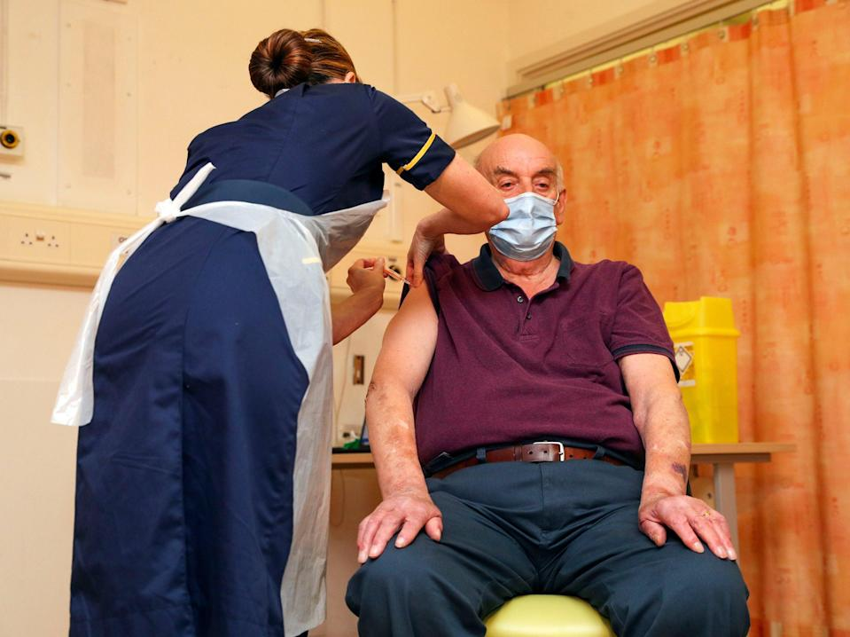 <p>Brian Pinker receives the Oxford University/AstraZeneca vaccine from nurse Sam Foster at the Churchill Hospital in Oxford</p> (Steve Parsons/PA)