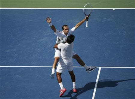 Leander Paes (R) of India and Radek Stepanek of the Czech Republic celebrate winning match point against Bob and Mike Bryan of the U.S. in their men's doubles match at the U.S. Open tennis championships in New York September 5, 2013. REUTERS/Adam Hunger