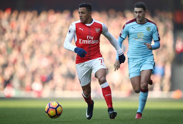 <p>Alexis Sanchez takes the ball on during the Premier League clash with Burnley </p>