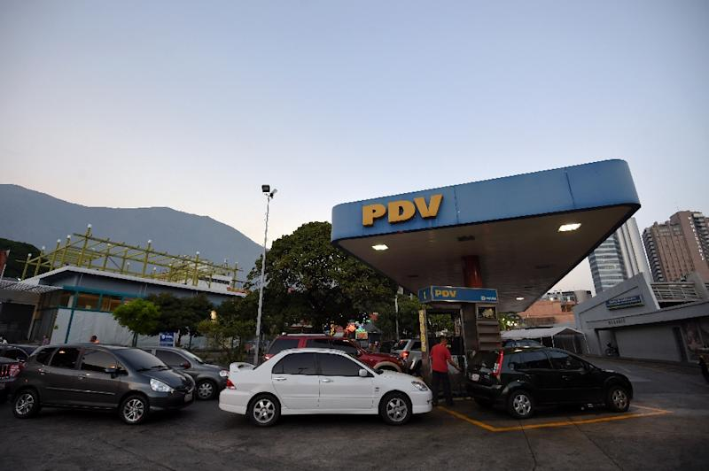 Cars wait in line at a gas station in Caracas on February 17, 2016 after President Nicolas Maduro said he would raise the price of gasoline for the first time in 20 years (AFP Photo/Juan Barreto)