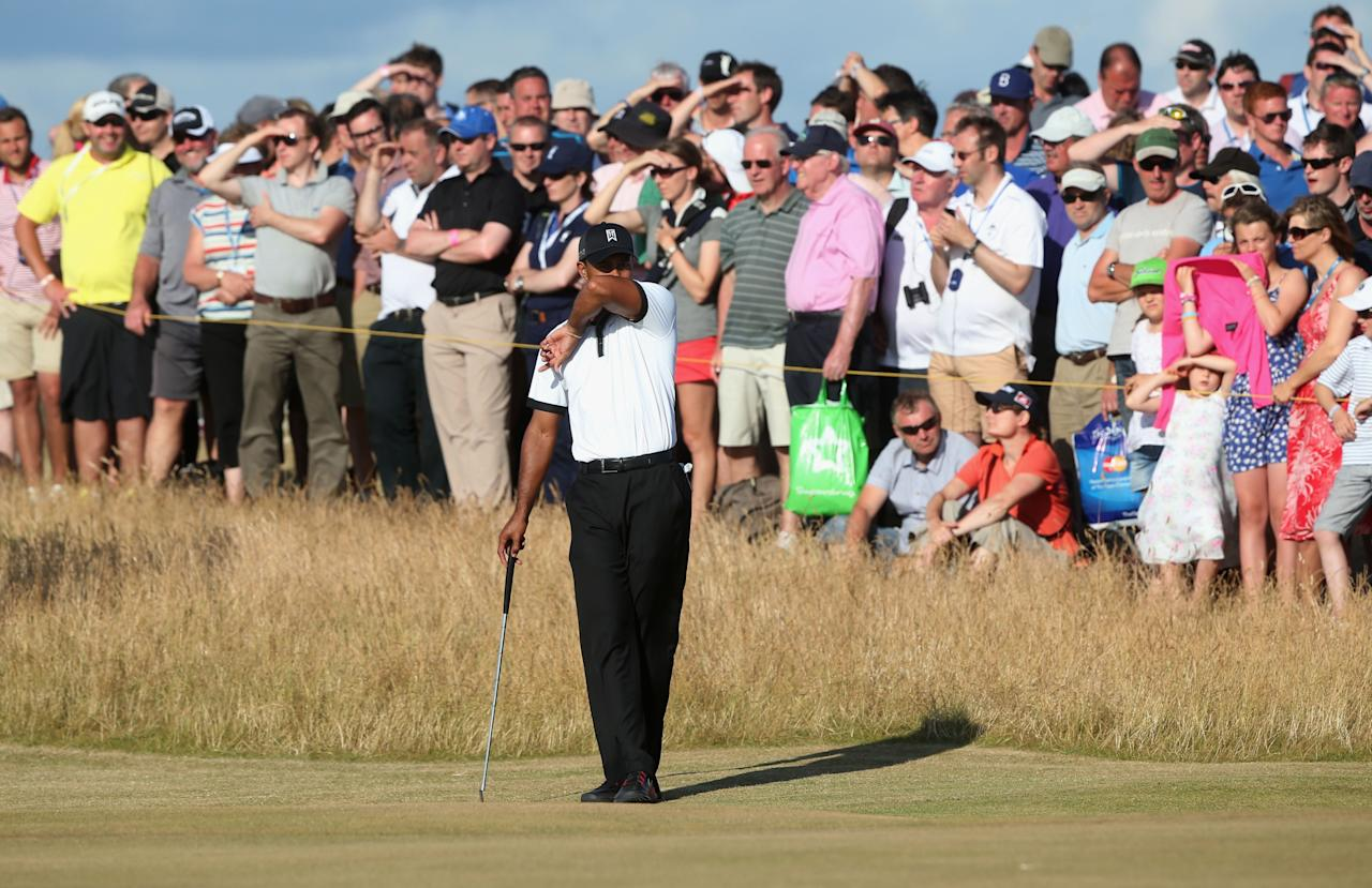 GULLANE, SCOTLAND - JULY 18: Tiger Woods of the United States on the 14th green during the first round of the 142nd Open Championship at Muirfield on July 18, 2013 in Gullane, Scotland. (Photo by Andrew Redington/Getty Images)