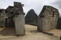 The Machu Picchu archeological site is devoid of tourists while it's closed amid the COVID-19 pandemic, in the department of Cusco, Peru, Tuesday, Oct. 27, 2020. Currently open to maintenance workers only, the world-renown Incan citadel of Machu Picchu will reopen to the public on Nov. 1. (AP Photo/Martin Mejia)